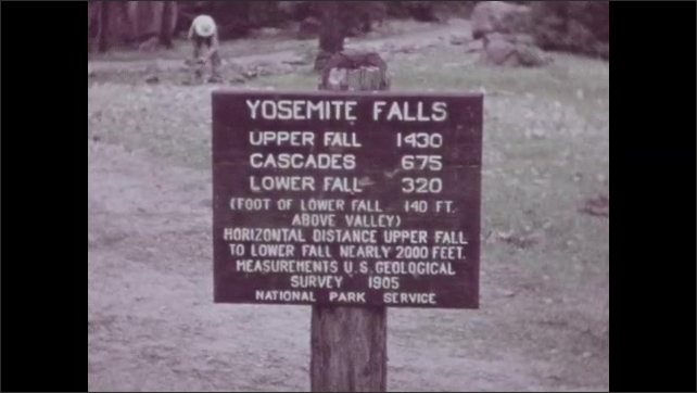 "1940s: Mountain.  Trees.  Sign describes ""YOSEMITE FALLS.""  Waterfall."