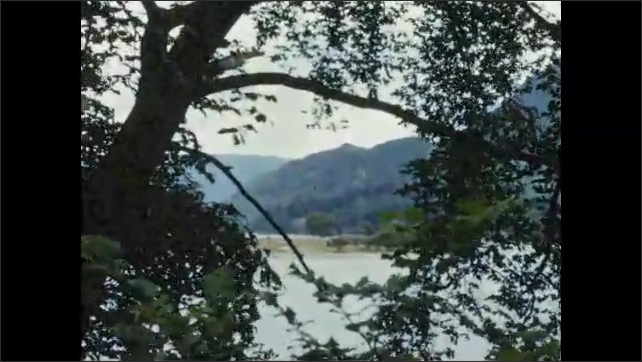 1950s: EUROPE: Lake Country.  Lake District, Cumbria. View across lake. Boat on water. Summer in lakes.