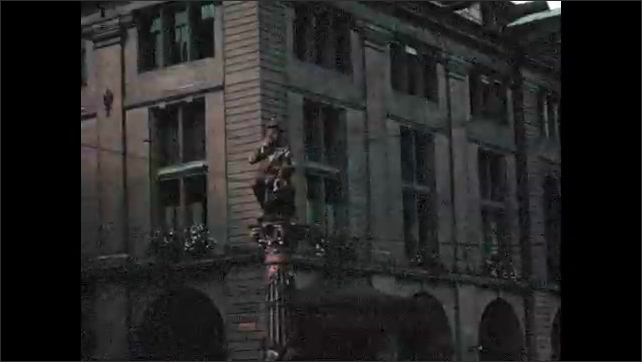 1950s: EUROPE:  Clock in Bern. Golden man strikes bell of clock. Sculptures and architectural details in Bern.