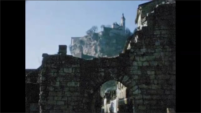 1960s:  EUROPE: city walls around castle on hill top. Castle made from stone.