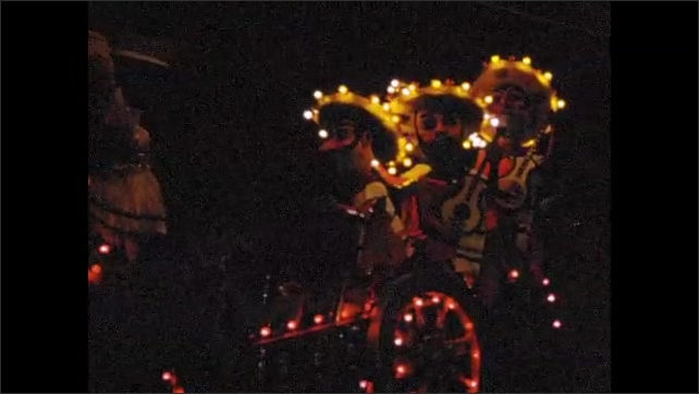 1960s:  EUROPE: city carnival at night. Floats in parade. Lights on floats.
