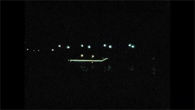 1970s: EUROPE: FRANCE: PARIS: bridge over the Seinne in Paris. Paris by night. River at night.