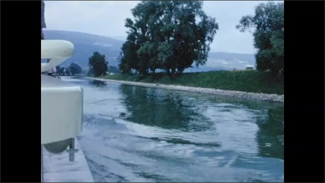 1970s: EUROPE: SWITZERLAND: NEUCHATEL: passengers disembark boat. Boat trip along waterway. Gravel on deck of boat