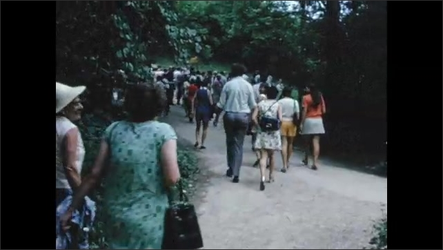 1970s: EUROPE: SWITZERLAND: NEUCHATEL: tug on water. Tourists walk along path. Visitors on path