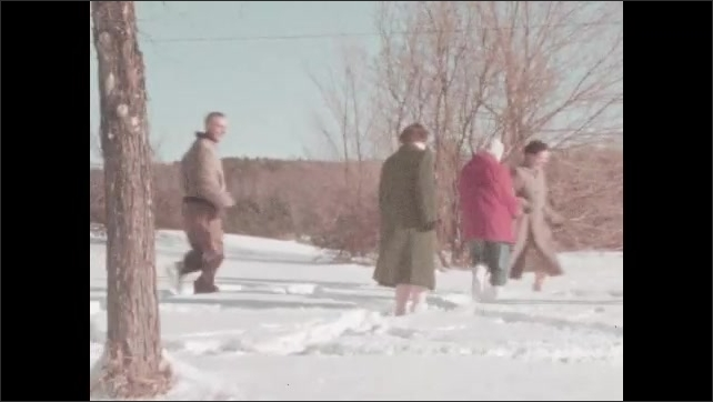 1950s: People run around in snow.