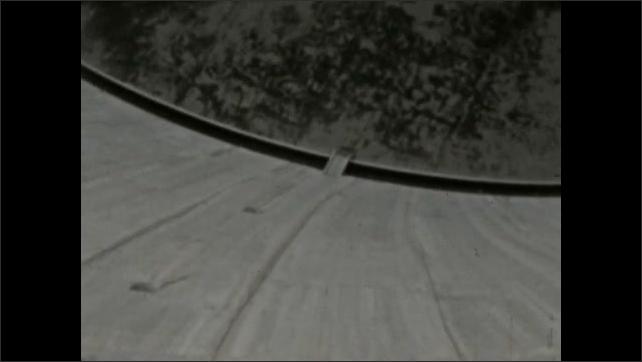 1930s: MEXICO: concrete dam in landscape. Canyon view. View into reservoir. Concrete structures