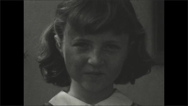 1940s: young girl smiling and then looking around her