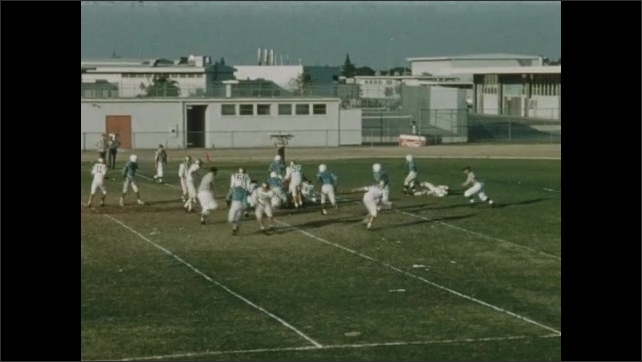 1940s: UNITED STATES: players run towards each other. Players stop.