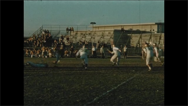 1940s: UNITED STATES: players run towards each other.