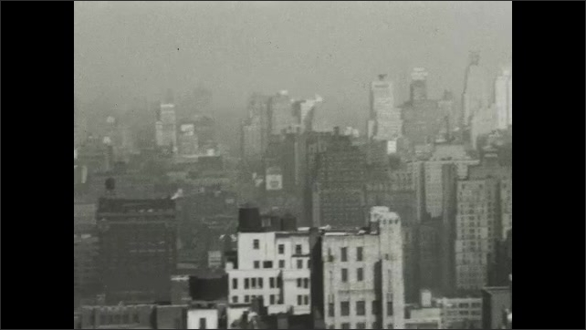 NEW YORK CITY 1940s:  foggy roof tops in New York city. City buildings in mist