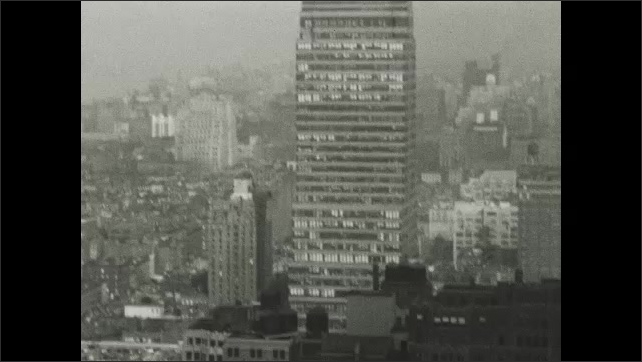 NEW YORK CITY 1940s: industrial buildings and chimneys by river in New York.