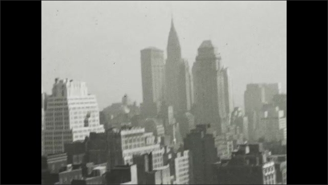 NEW YORK CITY 1940s: view across city blocks and buildings. Iconic buildings in New York.