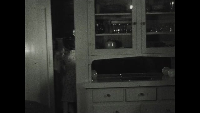 1930s: UNITED STATES: good night pops title. Girls wave goodnight to father. Girls take dolls to bed. Girls leave through door. Man sings by piano. Lady plays piano