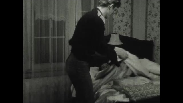 1930s: UNITED STATES: man rubs hands. Man in girl's bedroom at night. Man pulls sheet off sleeping girl. Man lifts girl from bed.