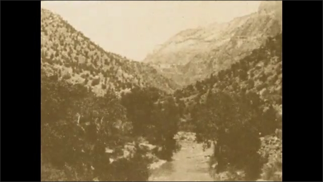 1920s: UNITED STATES: view along valley. Mountains and valley. River in valley