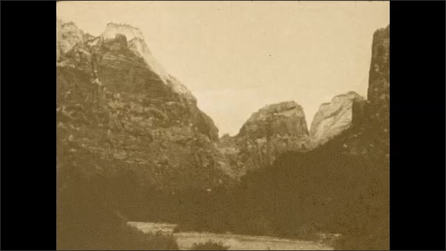 1920s: UNITED STATES: river and mountain range.