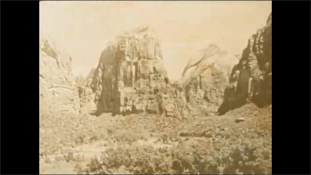 1920s: UNITED STATES: rock face and mountain range in Zion.