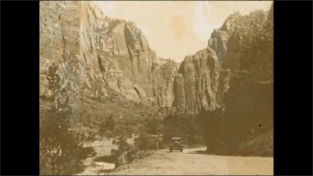 1920s: UNITED STATES: Temple of Sinewava. Car on highway in mountains