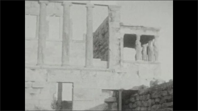 1920s: ruins in a city, woman and young girl play, ruins of an ancient building with columns still standing