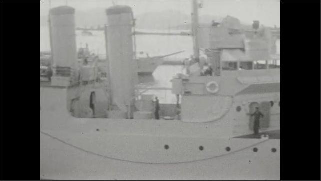 1920s: Pan across docked US battleship.