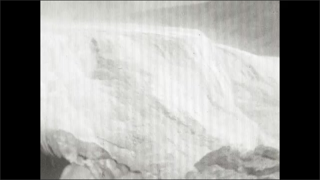 1920s: Rock formation over hot spring. Panning shots of hot springs.
