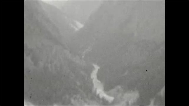 1920s: River runs through valley. Title card.