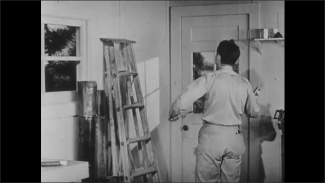 1940s: UNITED STATES: electrician tests switch action before installing box. Accepted height for switch.