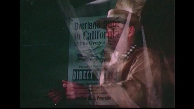 UNITED STATES 1950s: A poster is placed in a window.  A close up of a man in rain gear steering a ship.