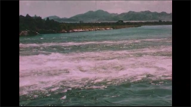 UNITED STATES 1950s: A parched landscape.  A raging river torrent.  A house in the midst of a flood.
