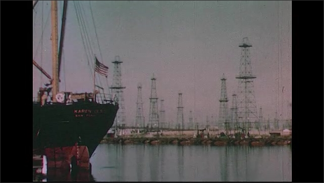 UNITED STATES 1950s: Several shots of oil wells, both inland and offshore.