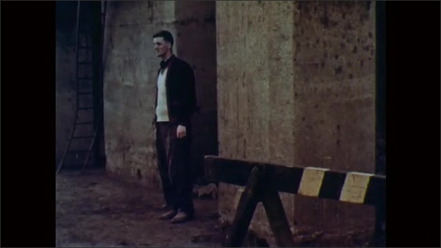 1960s: Man furtively looks around.  Cigarette package on ground.  Man emerges to pick up package.