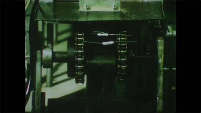 1970s: UNITED STATES: machinist works in industry. Plant operator. Capacitors produced at plant.