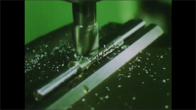 1970s: UNITED STATES: milling machine perfects metal design. Metal shavings from milling machine.