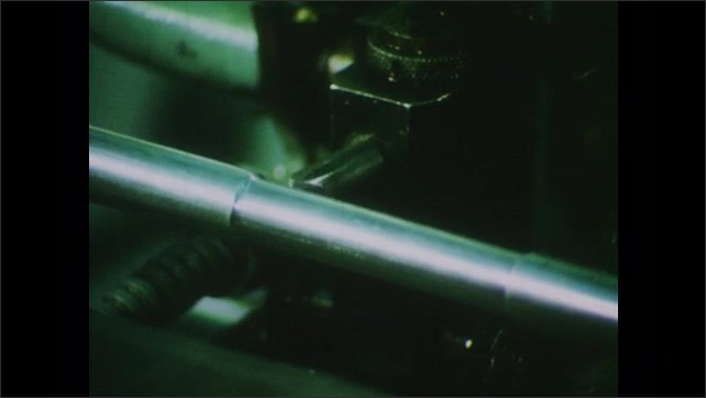 1970s: UNITED STATES: close up of metal component in machine. Metal shavings. Precision tool and dye manufacture.
