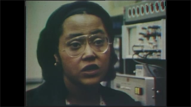 1970s: Black woman Research Psychologist Dr. Patricia Cowlings speaks in a lab. Man with bare chest with electrodes on it.