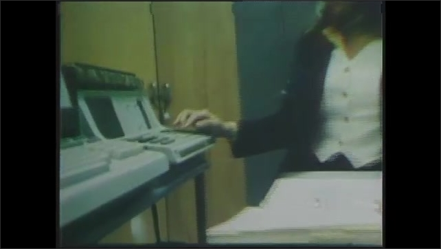 1970s: Sharon Orkansky, a computer programmer at NASA types on computer keyboard holding binder in her lap. Orkansky is interviewed in the lab.