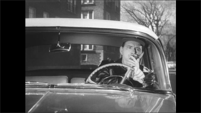 1950s: Man smoking cigar drives through stop sign and almost has an accident with a cab. Both cars brake. Man with cigar gestures angrily. Cab driver lets other car pass.