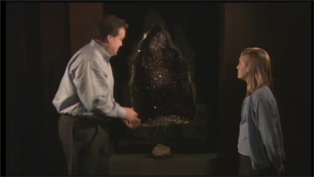2000s: UNITED STATES: examples of minerals. Man talks to girl. Man demonstrates hardness test with glass.