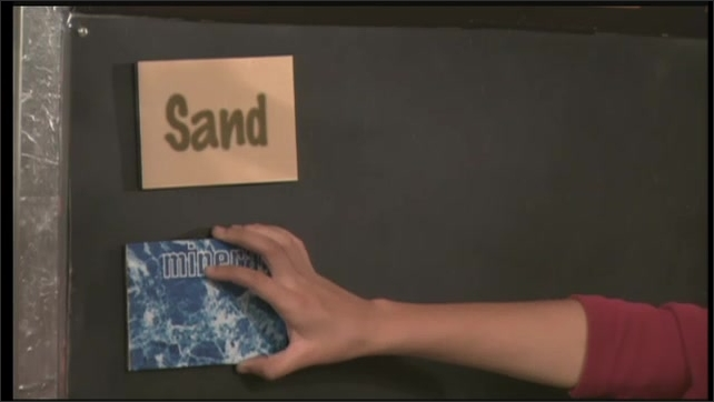 2000s: UNITED STATES: composition of sand. Minerals in sand. Label on blackboard.