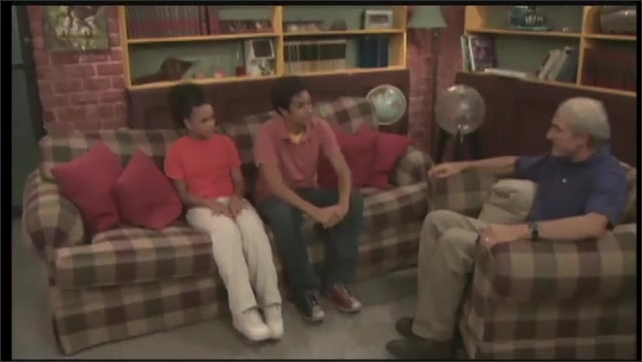 2000s: UNITED STATES: teenagers talk to man on sofa. Man listens to teens
