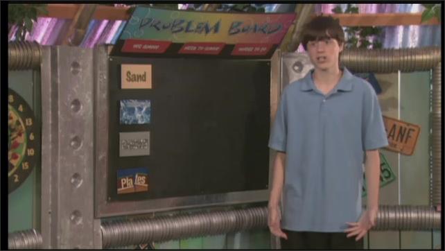 2000s: UNITED STATES: boy puts cards on blackboard. Girl talks to camera.