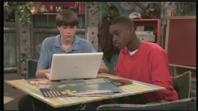 2000s: UNITED STATES: boy listens to man. Students look at computer screen. Video postcard from Alaska.