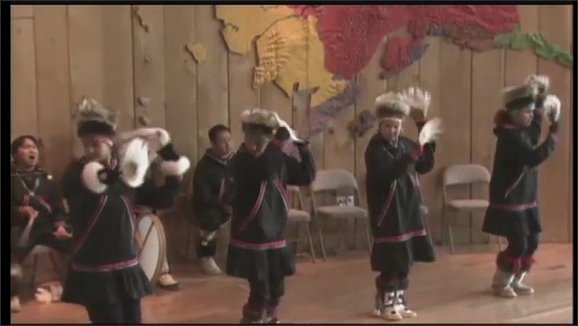 2000s: UNITED STATES: traditional Alaskan dance. Inuit dancers on stage.
