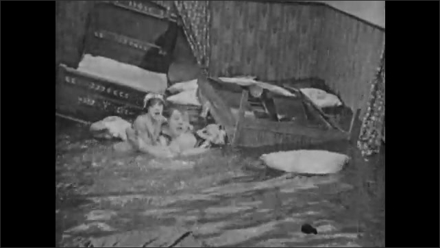 1940s: Dog swims through waves in ocean. Man and woman in flooded house at sea. Dog runs across land. Woman and man in flooded house. Dog runs across land.