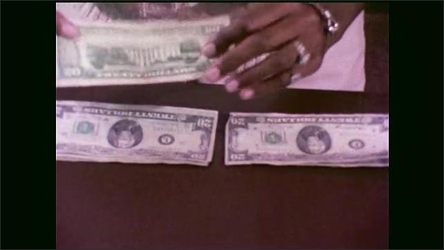 1970s: Man speaks and rests hand on copy machine.  Man gestures at documents.  Bank teller checks dollar bills.