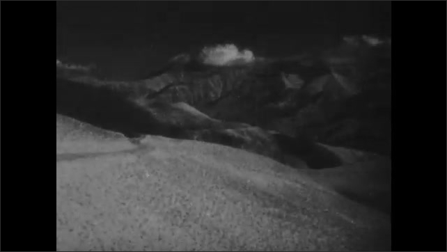 1940s: CAUCASUS, EUROPE: man in hat smiles at camera. Georgian Military Highway in mountains. Clouds over valley