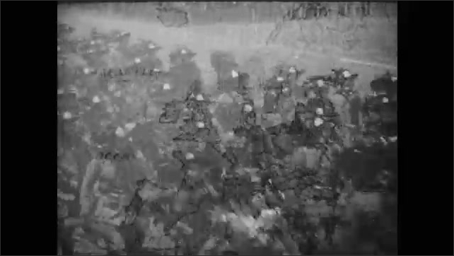 1910s: Soldiers marching in formation. Leader watches. Leader shouts at crowd. Hitler shouts. Soldiers march.