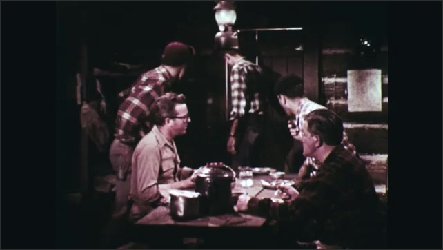1960s: Close up, man talking. Man eating, talks. Close up of man. Men stand from table, man talks. Close up of man talking. Man eating. Man talking.