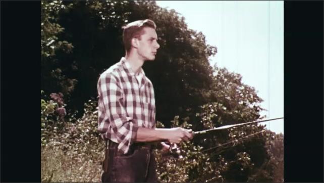 1960s: Man walking, points gun. Man fishing on shore. Fish caught on line. Man fishing. Men walking, cut through plants. Man looks at map, looks up.