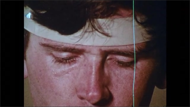 1970s: UNITED STATES: man welds metal. Sparks fly from metal. Band around man's head. Man gets splinter in eye.